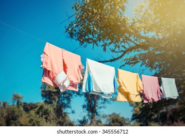 T-shirts hanging on a clothesline with blue sky