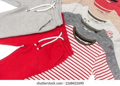 T-shirts with long sleeves and pants for boy isolated on white background/ Top view/ Flat lay