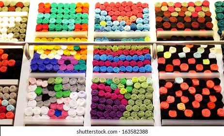 T-shirts rolled in shelf, Abstract background