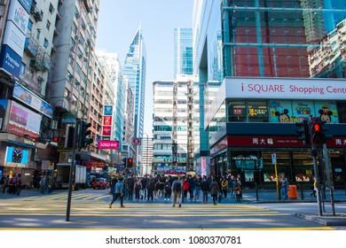 TSIM SHA TSUI, HONG KONG - January 09, 2018 :Many people walk in the street in Tsim Sha Tsui, The Tsim Sha Tsui street is a popular shopping place in Hong Kong