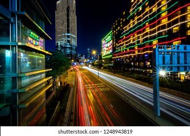 Tsim Sha Tsui, Hong Kong  - November 30, 2018 : Hong Kong Business District at Night with Light Track