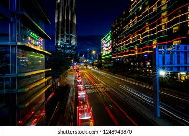 Tsim Sha Tsui, Hong Kong  - November 30, 2018 : Hong Kong Business District at Night with Light Track