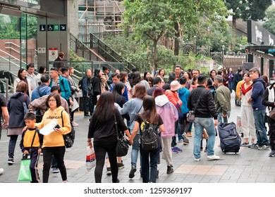 Tsim Sha Tsui, Hong Kong - 15 December, 2018 :  People walking across Canton Road Kowloon, Hong Kong. Canton Road is a major road in Hong Kong.