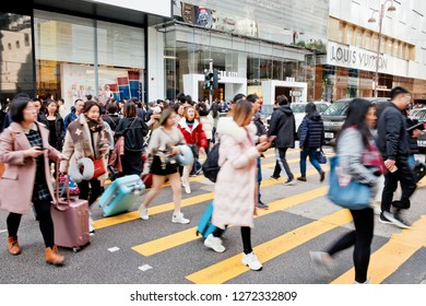 Tsim Sha Tsui, Hong Kong - 01 January, 2019 :  People walking across Canton Road Kowloon, Hong Kong. Canton Road is a major road in Hong Kong.