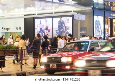 Tsim Sha Tsui, Hong Kong - March 20, 2019 : People walking across Canton Road Kowloon, Hong Kong. Canton Road is a major road in Hong Kong.