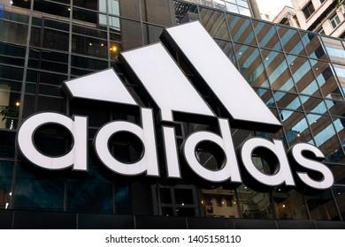Tsim Sha Tsui, Hong Kong, China - April 09, 2019: Adidas store brand logo seen in Hong Kong.