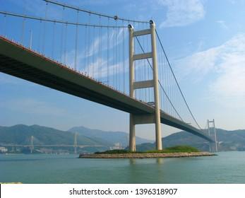 Tsing Ma Bridge from Ma Wan Tung Wan Beach in Hong Kong connect between Tsing Yi and Ma Wan. The span is the longest of all bridges in the world carrying rail traffic.