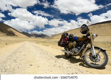 TSO KARI, JAMMU AND KASHMIR, INDIA - 06 JULY 2017: Motorbike Royal Enfield standing by the Karakorum Mountains near Leh, India. This region is a purpose of motorcycle expeditions organised by Indians