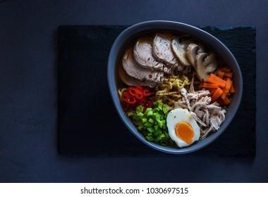 Tsukemen, Japanese dipping ramen noodles. Deadpan. Top view. Hor