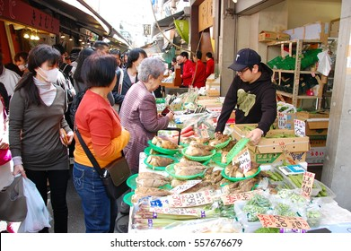 Tsukiji Fish Market in Tokyo - April 18, 2015: Tsukiji is the largest wholesale market of seafood and flesh produce in Japan. The relocation plan has been in controversy due to toxic soil.