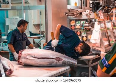 TSUKIJI FISH MARKET, TOKYO, JAPAN-30th OCTOBER 2019,Fish workers carving up large Tuna at the Tsukiji fishmarket.