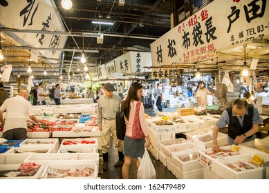 TSUKIJI, JAPAN - JULY 27 Merchants sale seafood in Tsukiji fish market on July 27, 2013 in Tsukiji, Japan. Tsukiji fish market is one of biggest fish market in the world