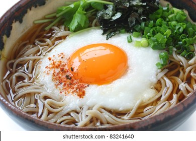 tsukimi tororo soba , buckwheat noodles with grated yam and raw egg yolk , japanese traditional food