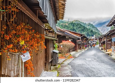 TSUMAGO, JAPAN - NOV 20, 2015: Scenic traditional post town in Japan from Edo period. Famous Nakasendo trail goes between Magome and Tsumago towns.