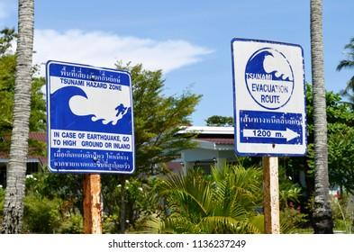 Tsunami Hazard Zone and Evacuation Route signs on Koh Muk