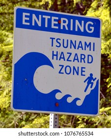 Tsunami hazard zone warning sign Vancouver Island British Columbia Canada