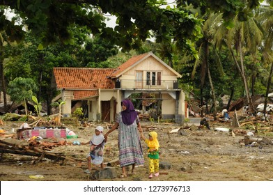 Tsunami victims standing in front of the damaged houses after being hit by tsunami on December 26, 2018 in Ujung Jaya village, Sumur district Banten province, Indonesia.