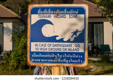 Tsunami warning sign at a beach in southern Thailand. Thai language instructions telling people to run to high ground and away from the beach immediately once the earthquake occurs.