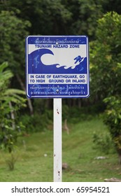 Tsunami warning sign on Mook Island in Thailand - travel and tourism.