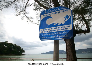 Tsunami warning sign at Patong beach, Phuket, Thailand.