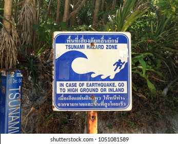 "Tsunami Warning Sign. the Thai text said. ""Tsunami Hazard Zone. In case of Earthquake, go to high ground or Inland"""