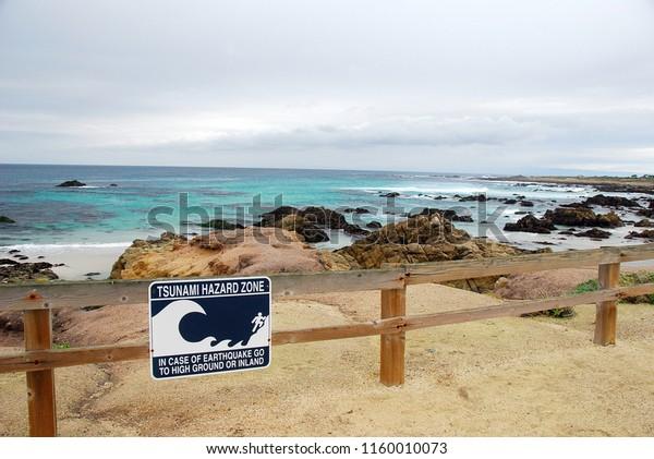 Tsunami Warning Signs Along Pacific Coastline Stock Photo