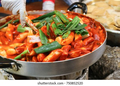 Tteokbokki, Korean spicy rice cake, is a popular street food made from cylinder-shaped white rice cake cooked with korean chilli paste, gochujang.