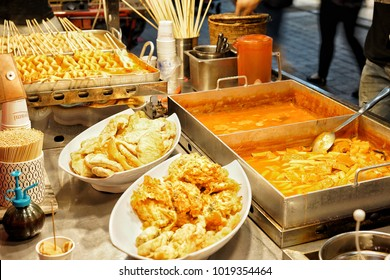 Tteokbokki (Rice Cake) and Oden (Fish Cake) is the Korean food that is famous food in Myeongdong night market, Seoul, South Korea on 20 September 2017