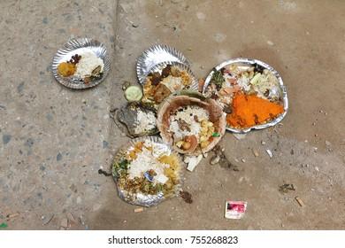 t=THAMEL, KATHMANDU NEPAL - SEPT 29, 2017: Plates of an offering on the ground during Dashain festival in Kathmandu, Nepal