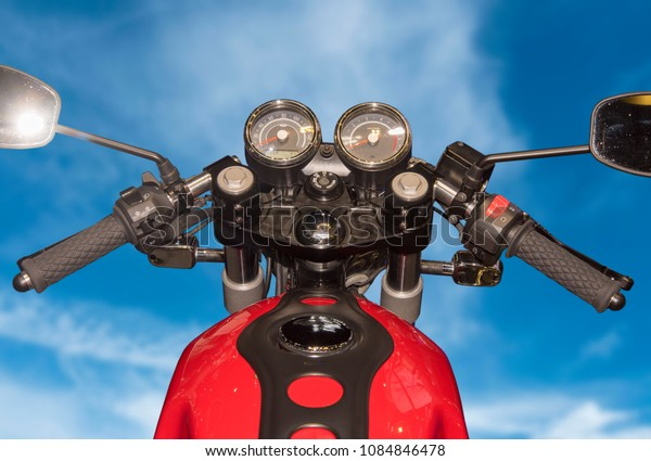 TThe view over the handlebars of a motorcycle to Motorcycle Trav