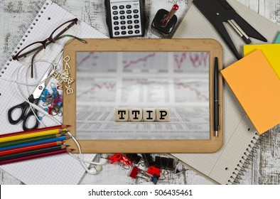 TTIP word built with letter cubes on a wooden blackboard