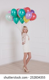 ttractive young woman with balloon on Valentine Day