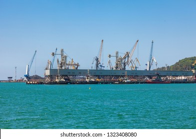 Tuapse, Russia - July 2, 2018: Seaport area, cranes and industrial district in Tuapse town