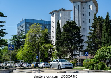 Tuapse, Russia - May 16, 2019: Beautiful view of modern Tuapse - a resort city on the Black Sea in Krasnodar region. Seaside Boulevard with cars on sunny spring day