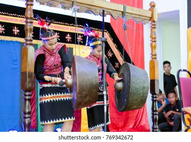 Tuaran Kota Kinabalu, Malaysia - December 02, 2017: Indigenous people of Sabah Borneo in East Malaysia playing a gong a traditional music instrument during Musical Festival.