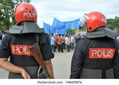 Tuaran Sabah Malaysia - Apr 20, 2013 : Police guarding during party supporter rally at 13th Malaysian General Election nomination day in Tuaran. General Election held every 5 years in Malaysia.