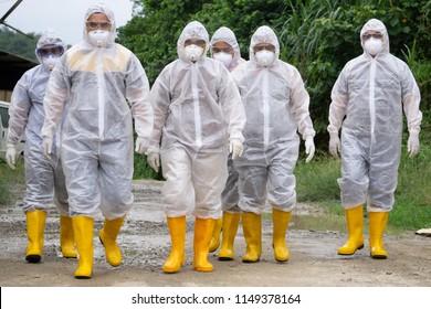 Tuaran Sabah Malaysia - Aug 4, 2018 : Veterinary worker wearing personal protection equipment (PPE) during avian influenza (bird flu) checking on chicken barn in Tuaran Sabah.