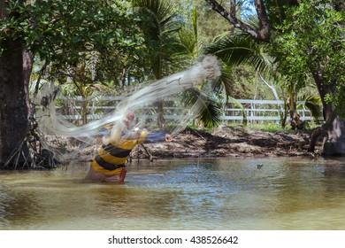 Tuaran, Sabah, Malaysia - June 7, 2016: Unidentified fisherman catch fish by throwing net.