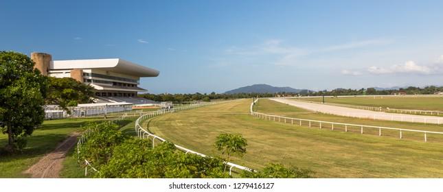 Tuaran, Sabah, Malaysia - November 28 2018: Panoramic view of the race course of Royal Sabah Turf Club (malay: Kelab Lumba Kuda Diraja Sabah) with the grandstand on the left side