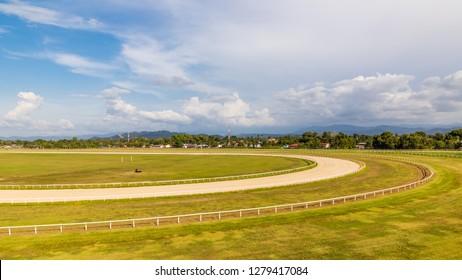 Tuaran, Sabah, Malaysia - November 28 2018: Southern curve  of the race course of Royal Sabah Turf Club (malay: Kelab Lumba Kuda Diraja Sabah) with the grandstand on the left side
