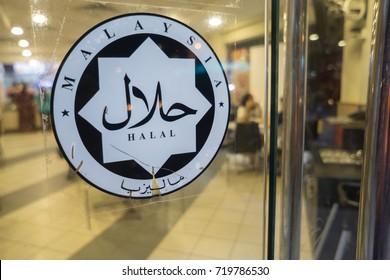 Tuaran Sabah Malaysia - Sep 21, 2017 :  Malaysian Halal logo at Kentucky Fried Chicken (KFC) Restaurant at Tuaran town. Halal is an assurance certification for eatery which adheres to Islamic law.