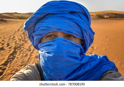 A tuareg takes a selfie in the desert