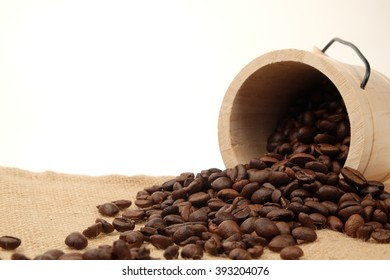 tub with roasted coffee beans white background