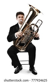 Tuba brass instrument. Wind classical musician isolated on white horn player trumpeter