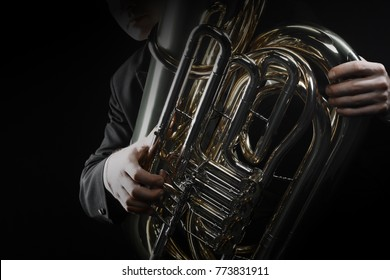 Tuba brass instrument. Wind music horn player. Orchestra instrument bass euphonium
