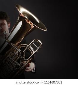 Tuba player brass instrument. Classical musician playing horn trumpet euphonium