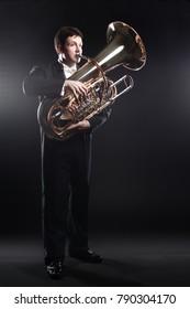 Tuba player brass instrument. Classical musician man horn player. Orchestra instrument bass euphonium