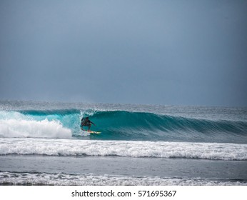 In the tube / Surfer messing with big wave / Bali