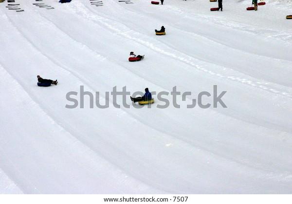tubing down a snowy hill