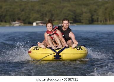 Tubing fun on a lake